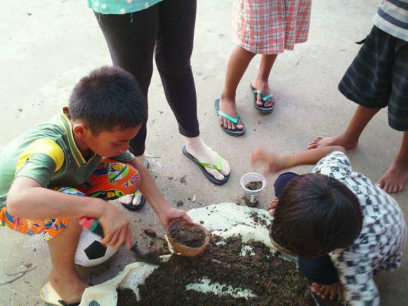 Digging the soil.